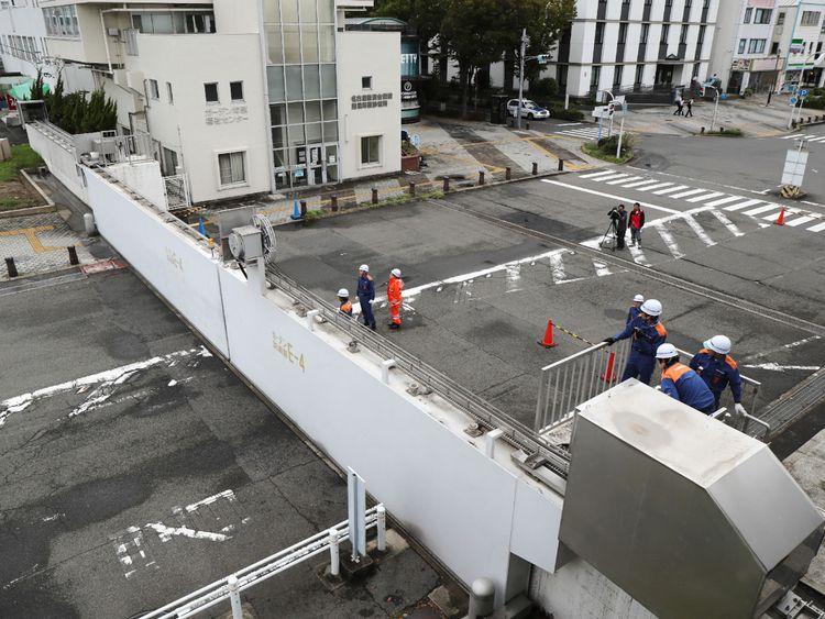 Nagoya port officers close the breakwater gates in Nagoya as Typhoon Jebi hit western Japan