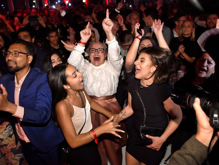 Social Democrat members celebrate despite the party bloc not getting a clear lead