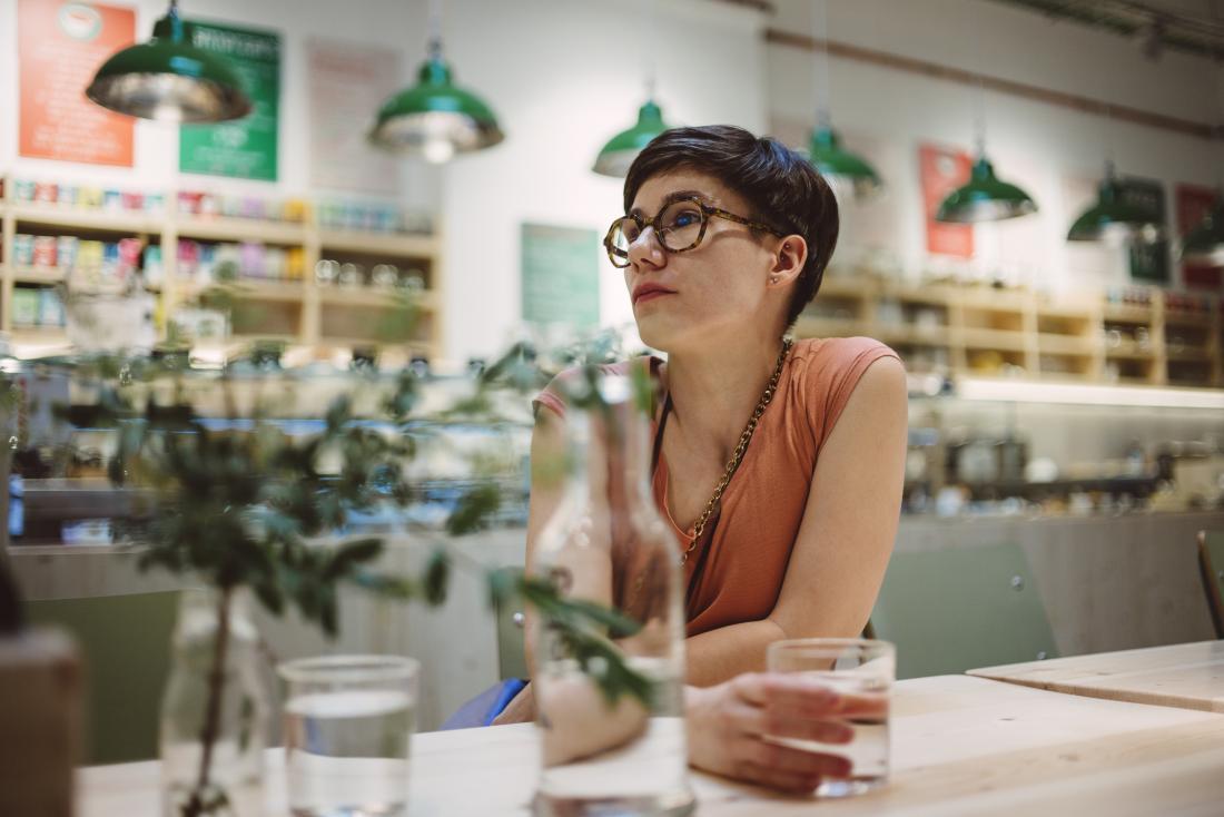 Woman in restaurant drinking water