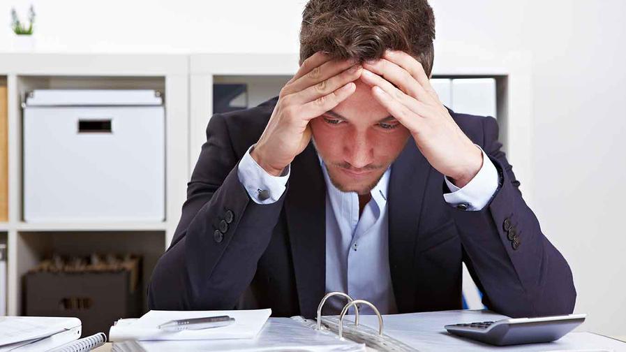 man stressed at work