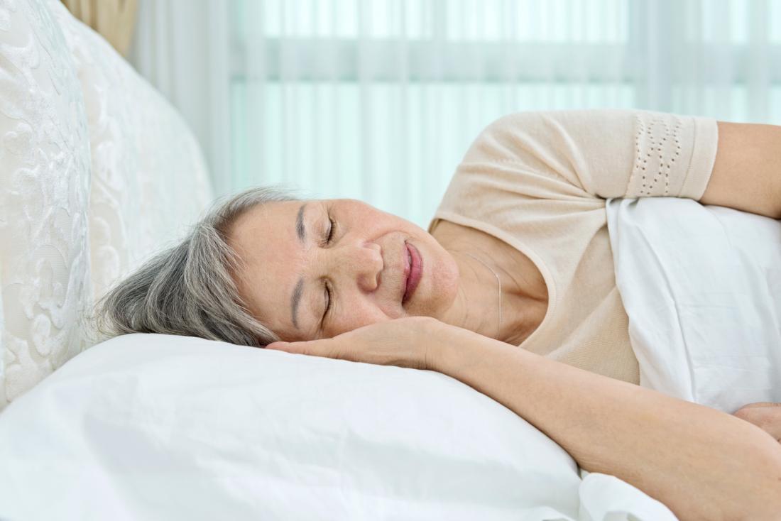senior asian woman sleeping