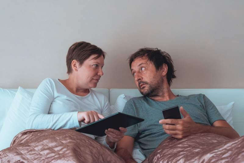 serious-couple-husband-and-wife-in-bedroom