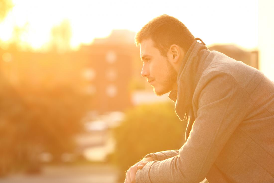 Pensive man at sunset