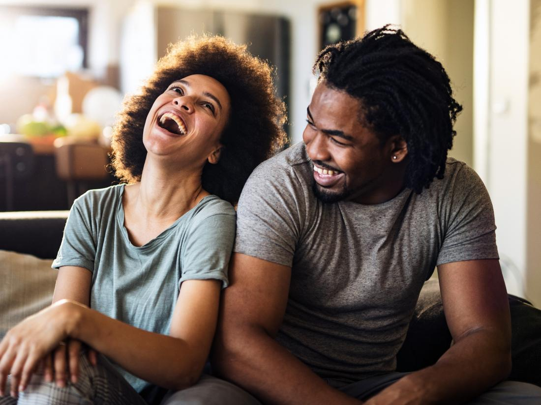 a couple looking happy despite having to wait for sex after a vasectomy