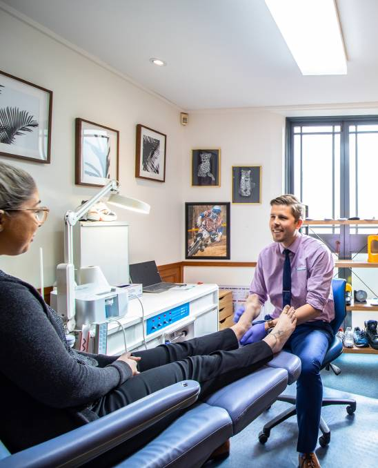 Stepping up: Podiatrist Ricky Lee ensures his patients are looking after their feet and maintaining good foot health practices.