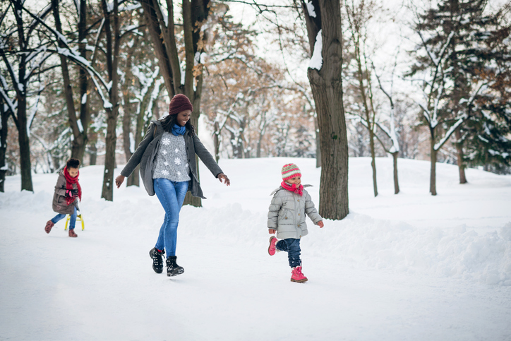 Mom and children playing in a wintry park