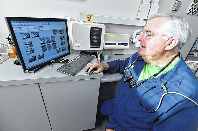 """<p>Dentist Gary Nataupsky looks at x-rays of a patient's teeth in his Kingston office.</p><p>Aimee Dilger   Times Leader</p><p>""""></a></p><p>Dentist Gary Nataupsky looks at x-rays of a patient's teeth in his Kingston office.</p><p>Aimee Dilger   Times Leader</p><p> <a href="""
