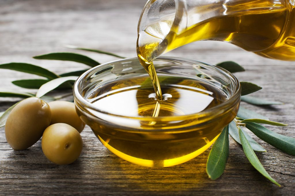 why extra virgin olive oil is so healthy, pouring olive oil