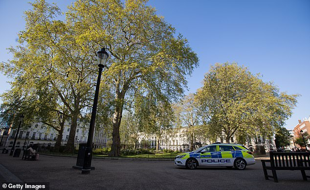 A police car in a quiet Fitzroy Square in London today. The British government has extended the lockdown restrictions first introduced on March 23