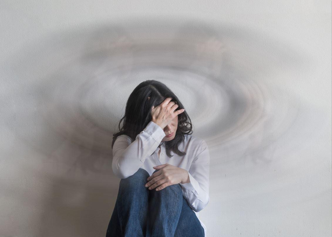Woman with migraine symptoms