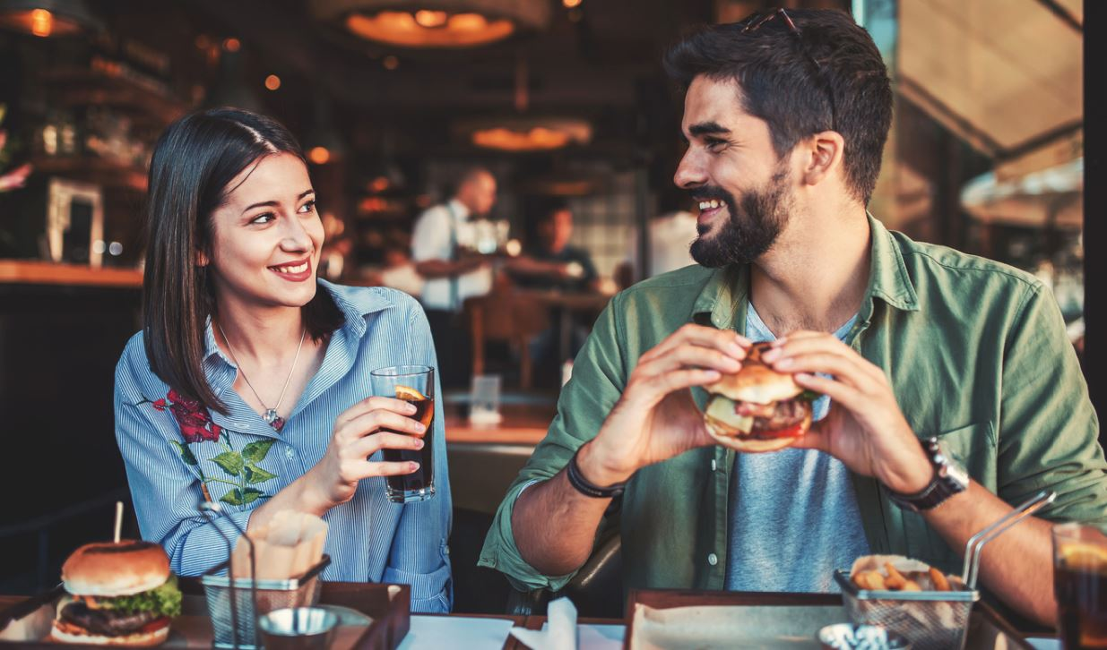 couple eating on first date ice breakers